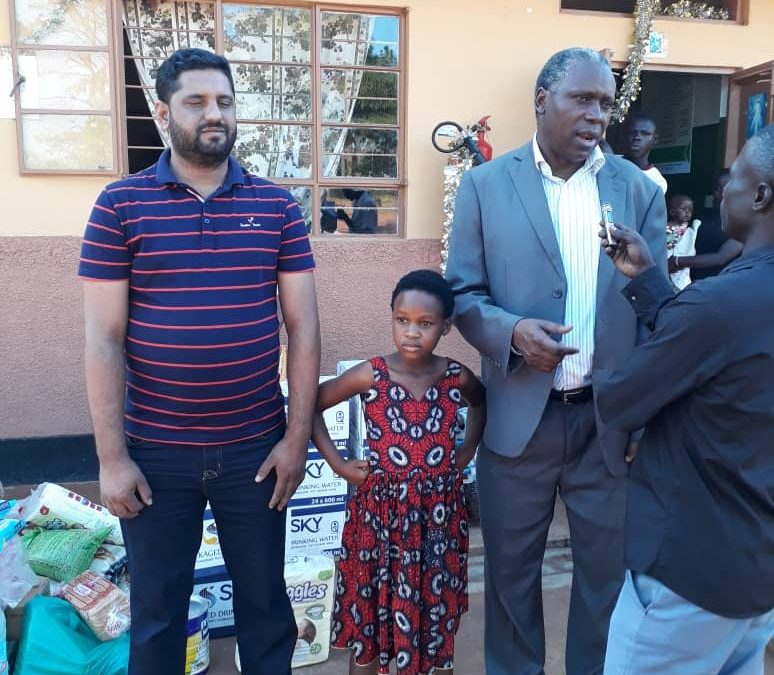 Ambassador Julius Peter Moto delivers Assortment of Items and Cash Donation to Lira Babies Home